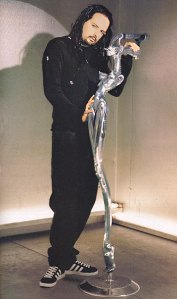 Jonathan Davis of Korn with his microphone stand designed by Giger